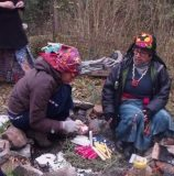 Nana Maria building the ceremonial fire to welcome the new era in 2012.